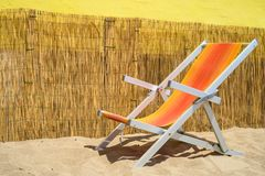 Deckchair on sand royalty free stock photography