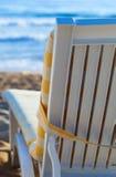 Deckchair on sandy beach of blue sea. Sun bed on sandy beach of blue sea Royalty Free Stock Image