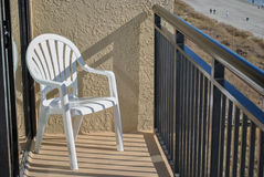 Deckchair seaside hotel. Beach hotel balcony deck chair in the fall afternoon Stock Photography
