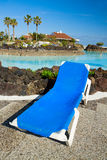 Deckchair standing by the tropical  pool Royalty Free Stock Image