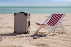 Deckchair with suitcase Stock Photo
