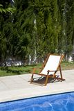 Deckchair in a swimming pool Stock Image