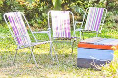 Deckchair and table in the garden Stock Photo