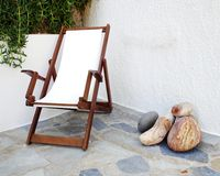 Deckchair in tranquil yard corner. Greece Milos island, deckchair in tranquil yard corner Royalty Free Stock Images