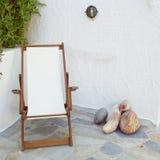 Deckchair in tranquil yard corner. Greece Milos island, deckchair in tranquil yard corner Stock Image