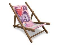Deckchair with the ukrainian money. Stock Image