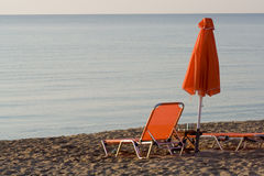 Deckchair and umbrella Stock Image