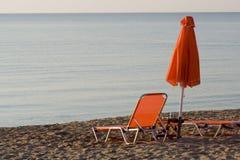 Deckchair and umbrella. Deckchairs and beach umbrella in greece Stock Image