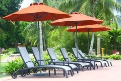 deckchairpoolside Royaltyfri Foto