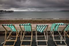 Deckchairs в городке взморья Стоковая Фотография