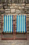 Deckchairs в городке взморья Стоковая Фотография RF