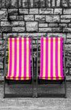 Deckchairs в городке взморья Стоковое фото RF