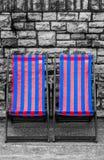 Deckchairs в городке взморья Стоковые Фото
