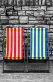Deckchairs в городке взморья Стоковое Изображение RF