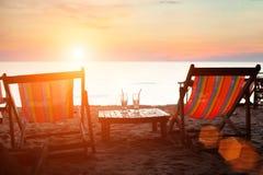 Deckchairs на пляже Стоковые Изображения RF