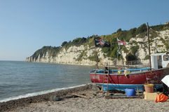 Deckchairs на пляже на пиве Стоковая Фотография RF