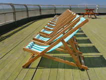 Deckchairs. Row of deckchairs royalty free stock photo