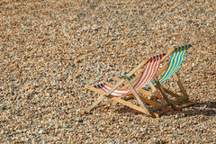 Deckchairs. Empty deckchairs on a pebbled beach in summer Stock Images