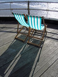 Deckchairs. On a pier Royalty Free Stock Photos