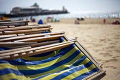 Deckchairs auf Promenade Lizenzfreies Stockfoto