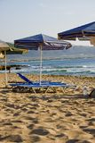 Deckchairs on the Beach. In Greece - Crete. Beautiful azure waves in the background Stock Photography