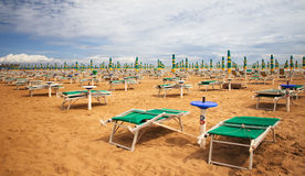 Deckchairs on beach Royalty Free Stock Photo