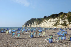 Deckchairs on beach at Beer Royalty Free Stock Photography