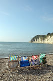 Deckchairs on beach at Beer Royalty Free Stock Images