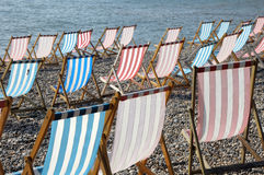 Deckchairs on beach at Beer Stock Photography