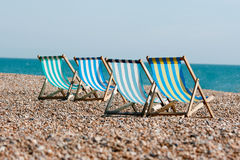 Deckchairs on the beach front Stock Photo