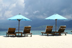 On the beach. Deckchairs on the beach of Gili Island in Indonesia royalty free stock photos