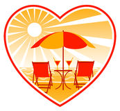 Deckchairs on beach in heart Stock Images