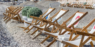 Deckchairs on the beach of Nice Royalty Free Stock Photos