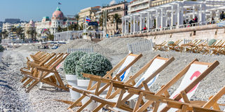 Deckchairs on the beach of Nice Stock Image