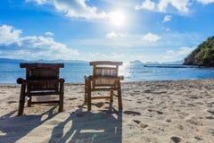 Deckchairs on the beach Stock Photos