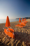 Deckchairs and beach umbrellas Stock Photography