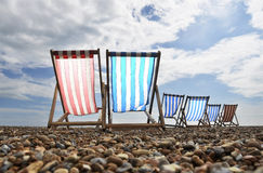 Deckchairs on Brighton beach Stock Photos