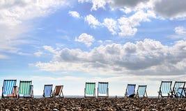 Deckchairs on Brighton beach. Empty deckchairs on Brighton beach, UK,HDR photography Stock Photography