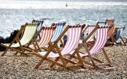 Deckchairs on Brighton beach. In summer, Sussex, England, UK Royalty Free Stock Photos