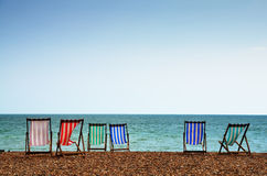 Deckchairs on Brighton Beach Stock Images
