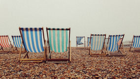 Deckchairs empty in Brighton, UK. Empty Deck Chairs on a foggy day in Brighton UK 2014. England, bad weather, folding chairs, beach, colours, colors Stock Photography