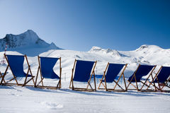 Deckchairs in front of slope Royalty Free Stock Images