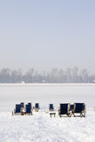 Deckchairs on a frozen lake Stock Photo