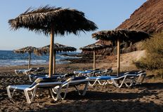 Deckchairs on a Lonely Desert Beach Royalty Free Stock Photography