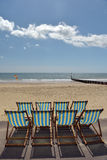 Deckchairs and loungers on beach,  Bournemouth Stock Image