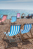 Deckchairs na praia Fotografia de Stock Royalty Free