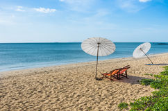 Deckchairs and Parasols on a solitary Beach. Panorama view of a solitary beach with parasols and deckchairs Royalty Free Stock Photography