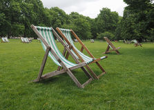 Deckchairs in a park Royalty Free Stock Photos