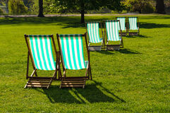 Deckchairs in a park Royalty Free Stock Photo