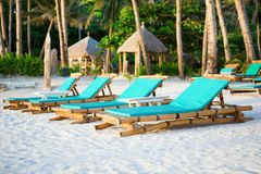 Deckchairs at the perfect white sand beach Royalty Free Stock Photos